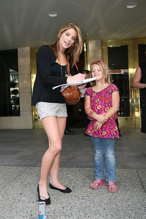 Ashley Greene stops for fans on her way to the Jonas brothers concert in Michigan on September 1, 2010