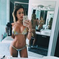 Cindy Prado in a bikini taking a selfie