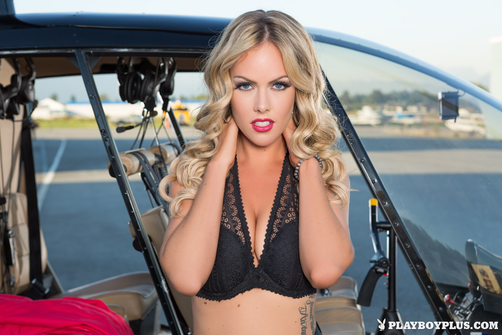 Playboy Cybergirl Heidi Michel posing nude with a helicopter