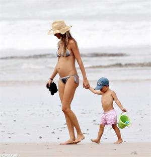A pregnant Gisele Bundchen walking on the beach in Costa Rica - July 23, 2012.  She is pregnant with her second child