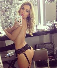 Emily Sears in lingerie taking a selfie and - ass