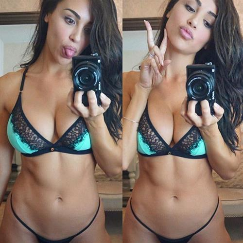 Ana Cheri in lingerie taking a selfie