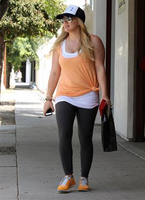 Hilary Duff Out in Los Angeles, August 30, 2012.  She's wearing a baseball cap and orange shirt as she leaves her personal trainers house