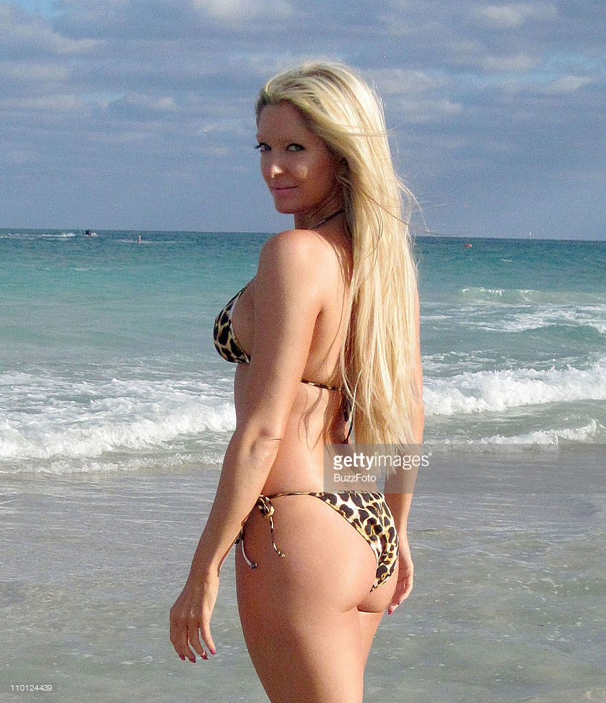 Erika Jayne in a bikini - ass