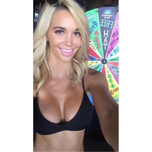 Caitlin Arnett in a bikini taking a selfie