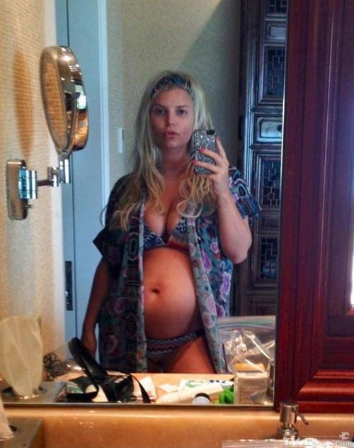 Jessica Simpson in a bikini taking a selfie