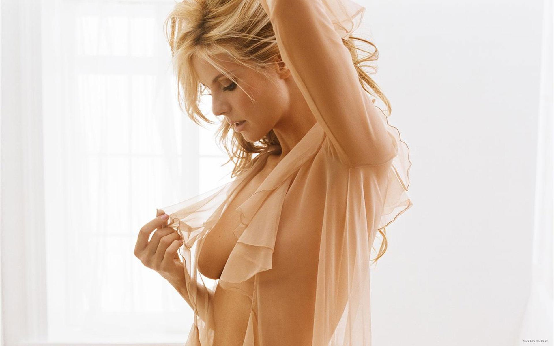 Heidi Klum topless... Just wearing some see through lace thing that is barely there