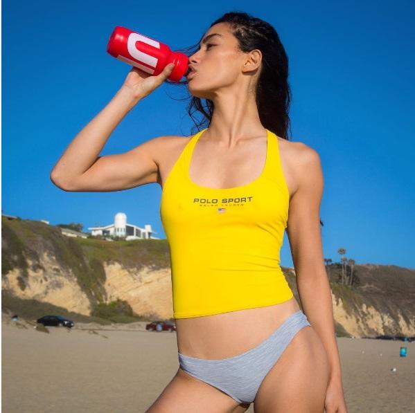 Adrianne Ho drinking