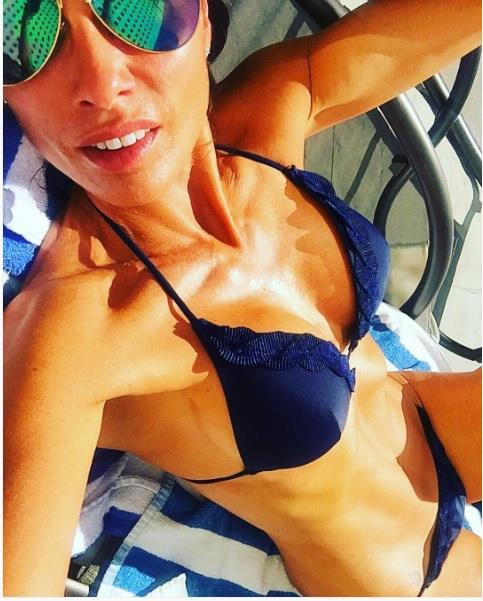 Melanie Sykes in a bikini taking a selfie