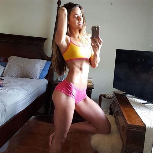 Valentina Lequeux in a bikini taking a selfie