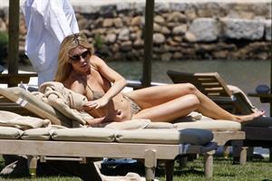 Abigail Clancy bikini candids in Italy on June 11, 2011