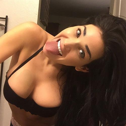 Kristina Basham in a bikini taking a selfie