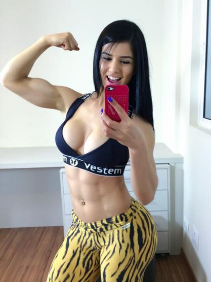 Eva Andressa in a bikini taking a selfie
