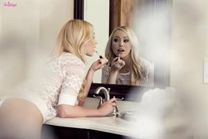 Brea Bennett doing her make-up in the bathroom