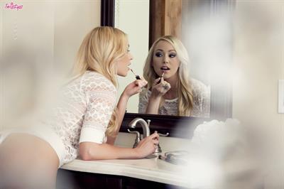 Brea Bennett doing her make-up in the bathroom