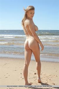 Viola Bailey strips off her black lingerie on the beach