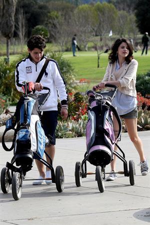 Selena Gomez golfing on February 2, 2010