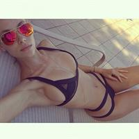Hannah Ferguson in a bikini taking a selfie