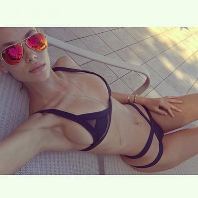 Hannah Ferguson in a bikini taking a selfie