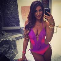 August Ames in a bikini taking a selfie
