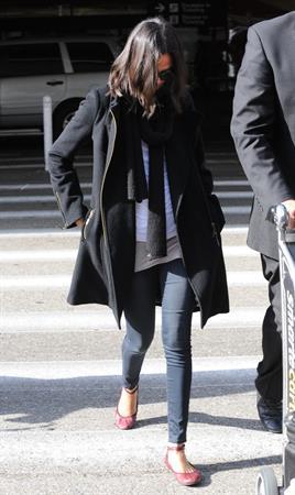 Zoe Saldana arriving into LA Airport - April 4, 2010