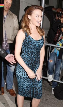 Kylie Minogue in blue and black leopard print dress