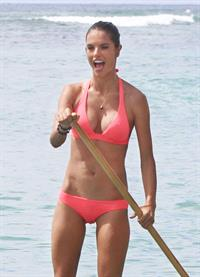 Alessandra Ambrosio paddleboarding in bikinis in Honolulu on October 12, 2011