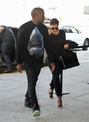 Kim Kardashian and Kanye West JFK airport in New York - 09 August 2012