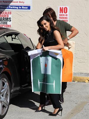 Kim Kardashian Spending the afternoon at the range with friend Jonathan Cheban in Miami (November 2, 2012)