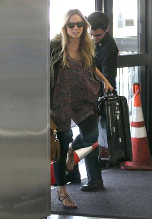 Kristen Bell - Departing on a flight at LAX - August 21, 2012