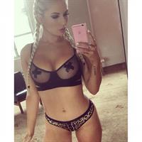 Amy Lee Summers in a bikini taking a selfie