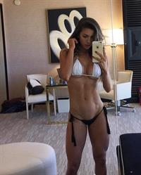 Anllela Sagra in a bikini taking a selfie