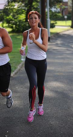 Amy Childs out jogging in Essex on August 1, 2011