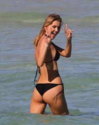 Deimante Guobyte in a bikini - ass