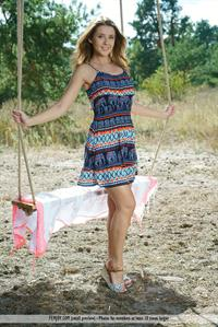 Davina E nude on a swing