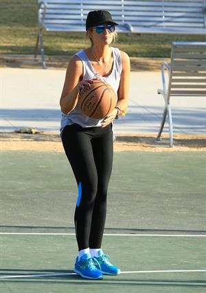 Delta Goodrem playing basketball with a friend in Los Angeles, California on November 3, 2013