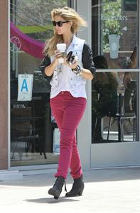 Delta Goodrem - Stopping to get a coffee on her way to work in Los Angeles, California - July 18, 2012