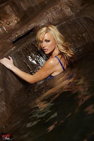 Kayden Kross swimming in blue lingerie