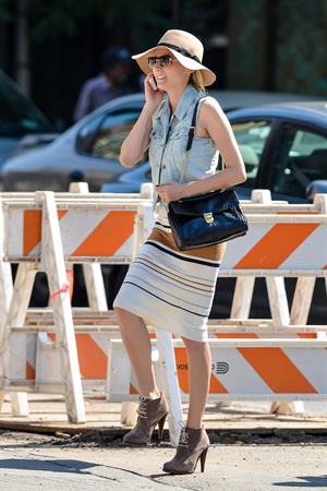 Diane Kruger - Wears a denim vest with a skirt as she chats on her cellphone while out the Bowery on September 12, 2012