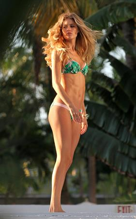 Doutzen Kroes in a bikini for a Victoria's Secret photoshoot in Miami 9/12/12