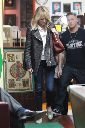 Emma Stone Stopped at Shamrock Tattoo - October 17, 2012