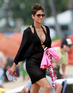 Halle Berry in a black bikini while hitting the beach in Hawaii on March 26, 2013