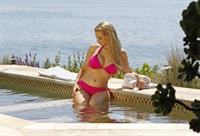 Holly Madison - In a pink bikini at Laguna Beach in California Sept 6, 2012