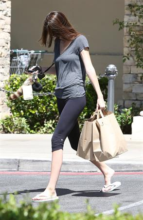 Kendall Jenner Hides her face while strolling through Calabasas on May 29, 2013