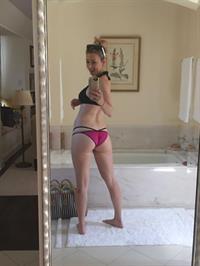 Iliza Shlesinger in a bikini taking a selfie and - ass