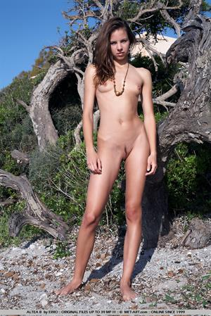 Altea B nude roaming the rocky landscape