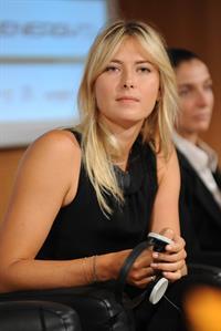 Maria Sharapova attends a press conference to present Saturday's exhibition match Milan November 30, 2012