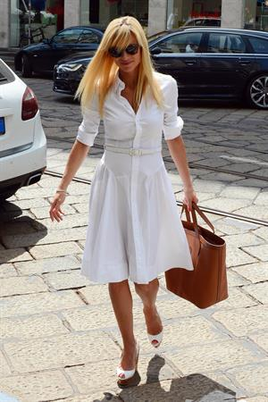 Michelle Hunziker Leaving her house in a white dress in Milan Italy on May 9, 2013
