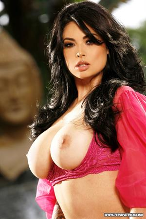 Tera Patrick in red/pink lingerie by the pool