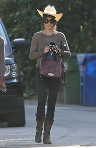 Nikki Reed walking and wearing her cowboy hat in Los Angeles on February 21, 2013